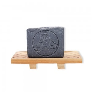 activated charcoal soap on soap dish front view