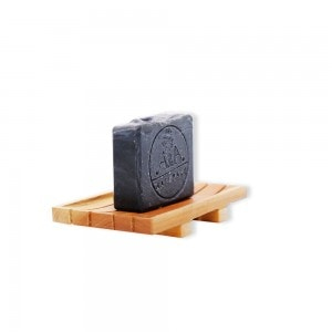 activated charcoal soap on soap dish side view