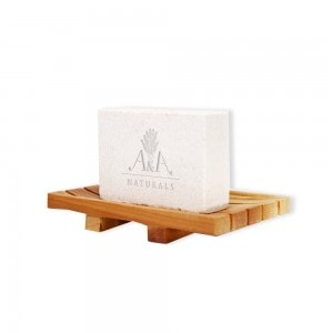 pink himalayan soap bar on soap dish side view