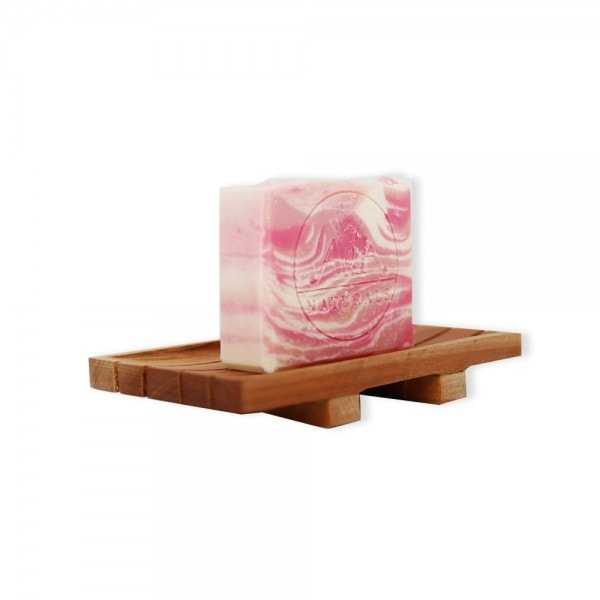 rose geranium soap bar on soap dish side view